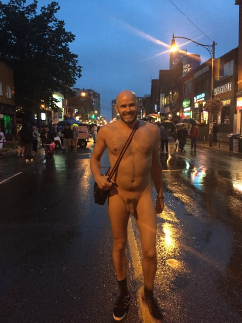 Jade Sambrook naked in the rain on Church Street at Toronto Pride 2015.